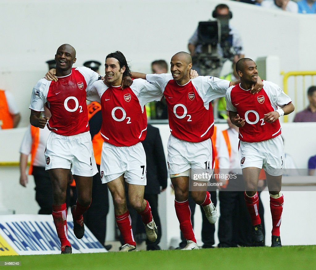 Patrick Vieira, Robert Pires, Thierry Henry and Ashley Cole of Arsenal celebrate after the second goal during the FA Barclaycard Premiership match between Tottenham Hotspur and Arsenal at White Hart Lane on April 25, 2004 in London.