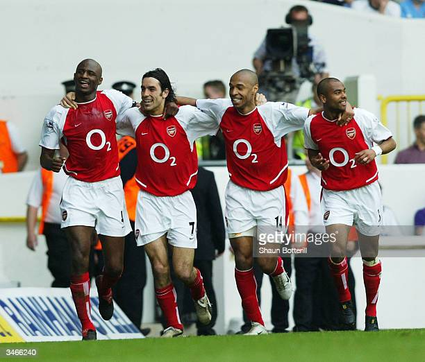 Patrick Vieira, Robert Pires, Thierry Henry and Ashley Cole of Arsenal celebrate after the second goal during the FA Barclaycard Premiership match...