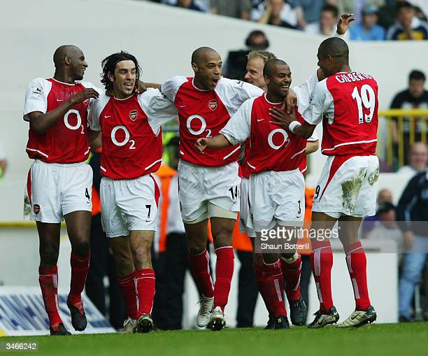 Patrick Vieira Robert Pires Thierry Henry Ashley Cole and Gilberto Silva of Arsenal celebrate after the second goal during the FA Barclaycard...