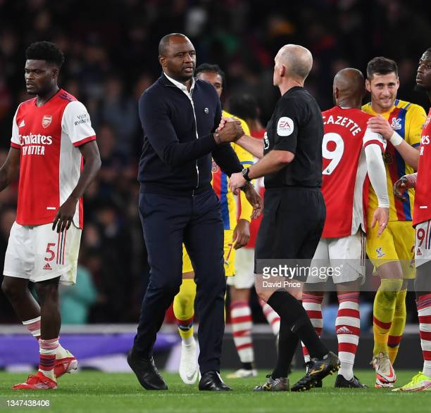 Patrick Vieira the Palace manager shakes hands with Referee Mike Dean after the Premier League match between Arsenal and Crystal Palace at Emirates...