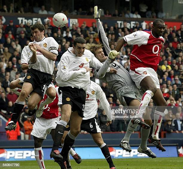 Patrick Viera of Arsenal causes problems for the Manchester United goalkeeper Roy Carroll during the FA Cup Semi Final match between Arsenal and...