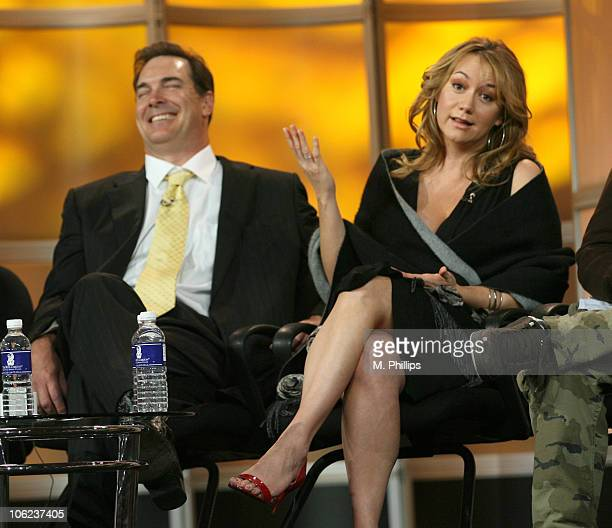Patrick Warburton and Megyn Price of Rules of Engagement