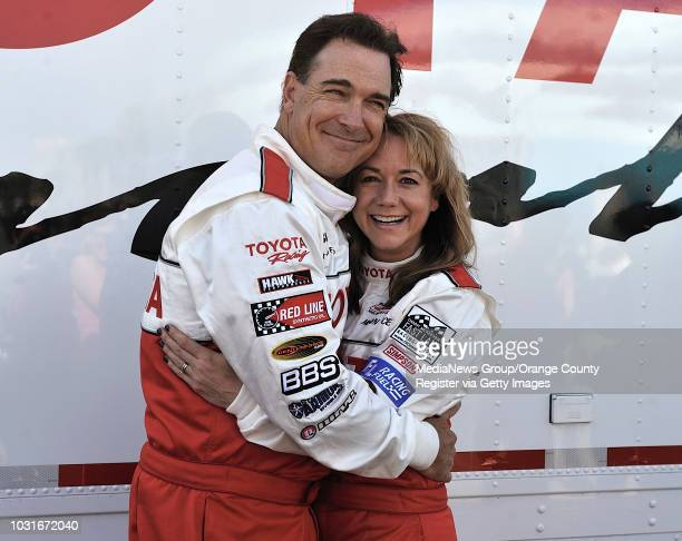 BEACH CA Patrick Warburton with his TV wife Megyn Price during the media day for the Toyota Grand Prix of Long Beach on April 6 2010 The pair are on...