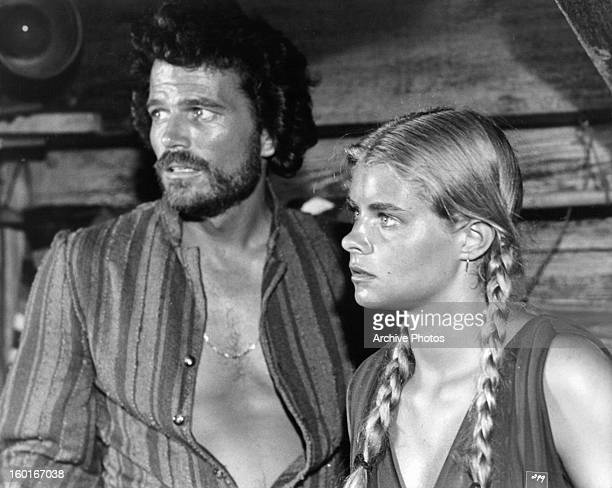 Patrick Wayne and Taryn Power look with concern in a scene from the film 'Sinbad And The Eye Of The Tiger' 1977