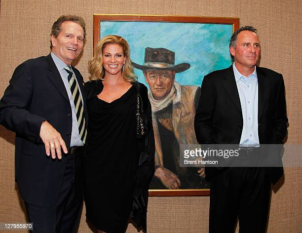 Patrick Wayne Marisa Wayne and Ethan Wayne attend the Heritage Auctions John Wayne Auction special VIP press reception at the Hyatt Regency Century...