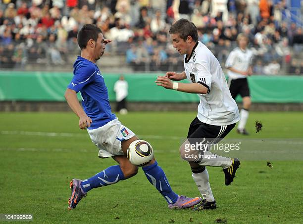 Patrick Weihrauch of Germany battles for the ball against Piana Luca of Italy during the U17 international friendly match between Germany and Italy...