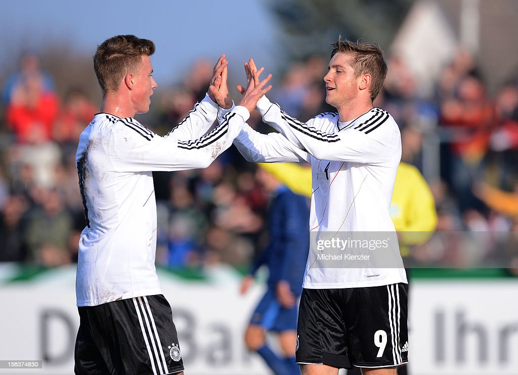 Patrick Weihrauch (r) of Germany celebrates scoring the opening goal with Yannick Gerhardt during the International Friendly match between U19 Germany and U19 France at Rheinstadium on November 14, 2012 in Kehl, Germany.