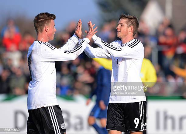 Patrick Weihrauch of Germany celebrates scoring the opening goal with Yannick Gerhardt during the International Friendly match between U19 Germany...