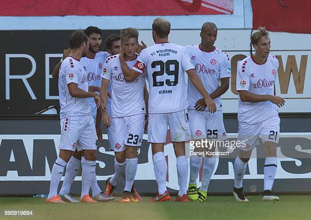 Patrick Weihrauch of Wuerzburg celebrates his team's first goal with team mates during the Second Bundesliga match between 1 FC Heidenheim 1846 and...