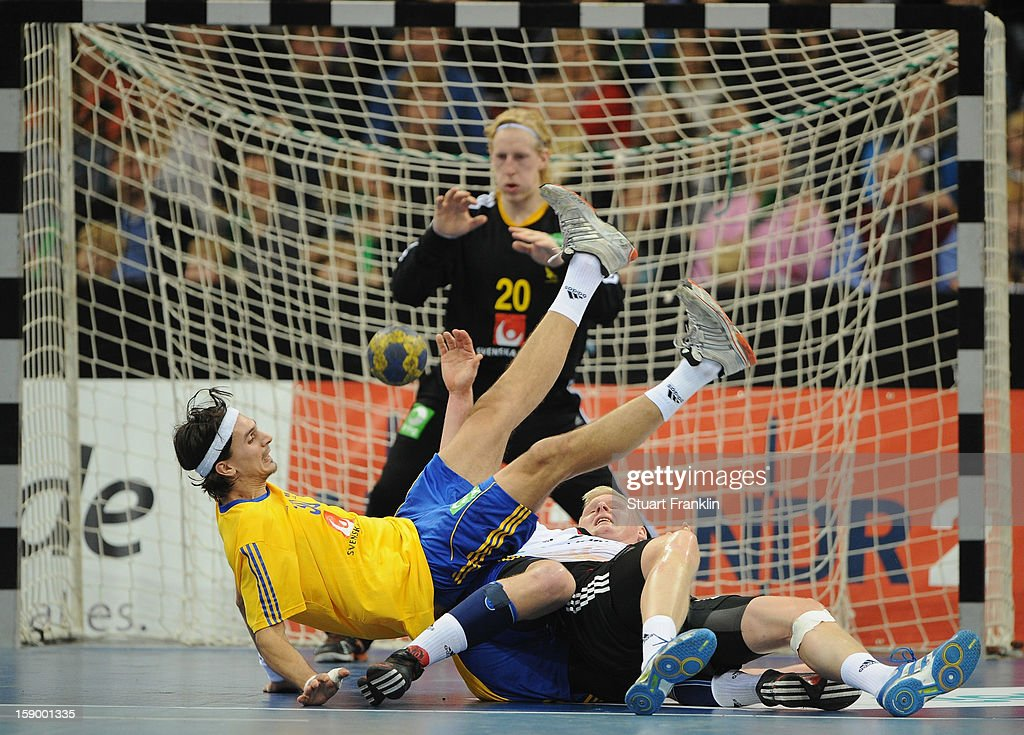 Patrick Weincek of Germany challenges for the ball with Jesper Neilsen of Sweden during the international handball friendly match between Germany and Sweden at O2 World on January 5, 2013 in Hamburg, Germany.