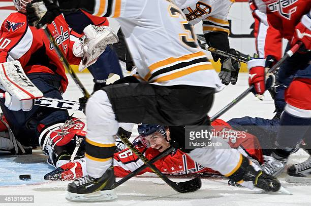 Patrick Wey of the Washington Capitals dives and reaches for the puck in attempt to stop a goal by Patrice Bergeron of the Boston Bruins in the third...