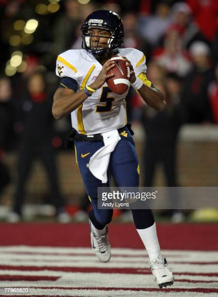 Patrick White of the West Virginia Mountaineers looks to pass the ball during the Big East Conference game against the Cincinnati Bearcats at Nippert...