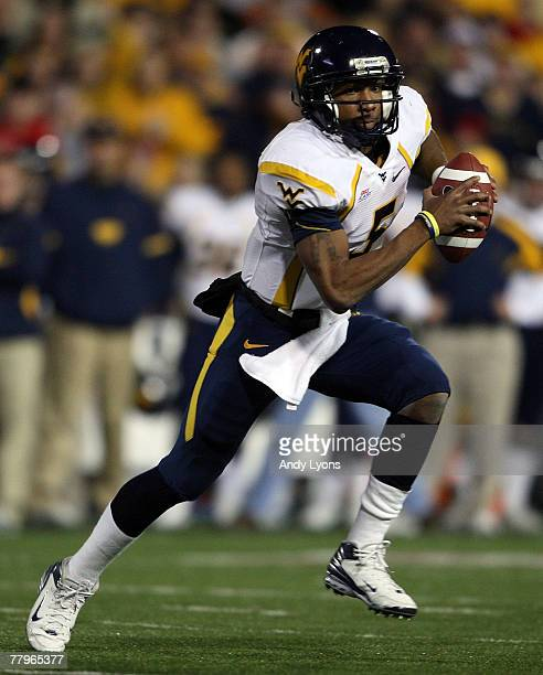 Patrick White of the West Virginia Mountaineers runs with the ball during the Big East Conference game against the Cincinnati Bearcats at Nippert...