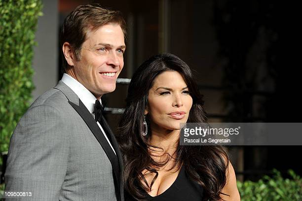 Patrick Whitesell and Lauren Sanchez arrive at the Vanity Fair Oscar party hosted by Graydon Carter held at Sunset Tower on February 27 2011 in West...