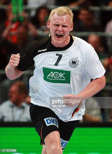 Patrick Wiencek of Germany celebrates a goal during the European Handball Championship 2016 Qualifier match between Germany and Spain at SAP Arena on...