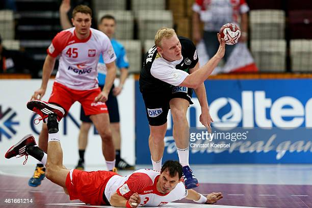 Patrick Wiencek of Germany challenges Krzystof Lijewski of Poland during the IHF Men's Handball World Championship group D match between Poland and...
