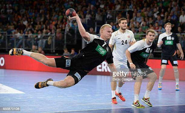 Patrick Wiencek of Germany throws the ball during the international friendly match between Germany and Switzerland at the Ratiopharm Arena on...