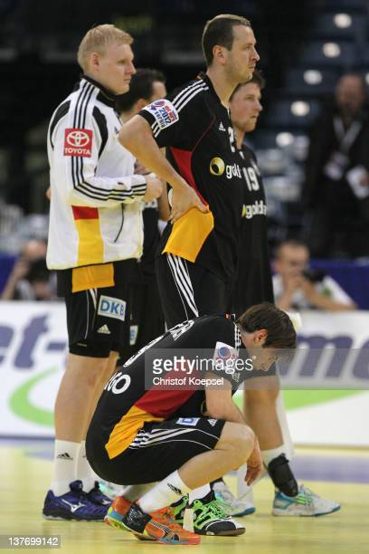 Patrick Wiencek, Pascal Hens and Uwe Gensheimer of Germany look dejcted after losing 32-33 the Men's European Handball Championship second round...