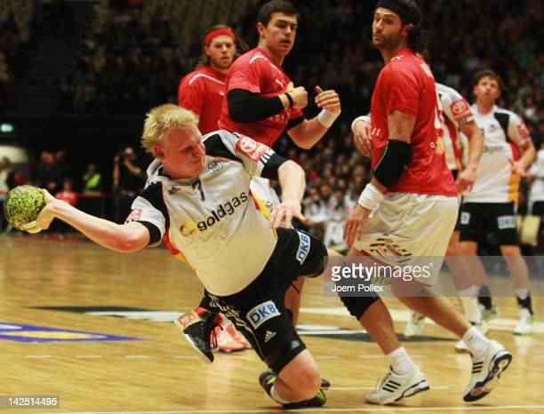 Patrick Wienchek of Germany scores during the Handball international friendly match between Denmark and Germany at Jyske Bank Boxen on April 6, 2012...