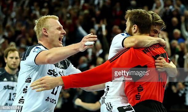 Patrick Wienczek of Kiel celebrate with his team mates Rune Dahmke and Andreas Wolff after the DKB HBL Bundesliga match between THW KIEl and SG...