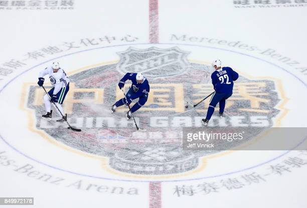 Patrick Wiercioch Alexander Edler and Daniel Sedin of the Vancouver Canucks skate a drill during their practice at MercedesBenz Arena September 20...