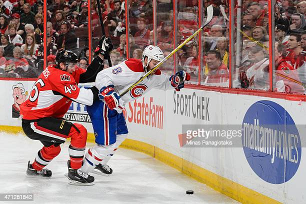 Patrick Wiercioch of the Ottawa Senators challenges Brandon Prust of the Montreal Canadiens near the boards in Game Six of the Eastern Conference...