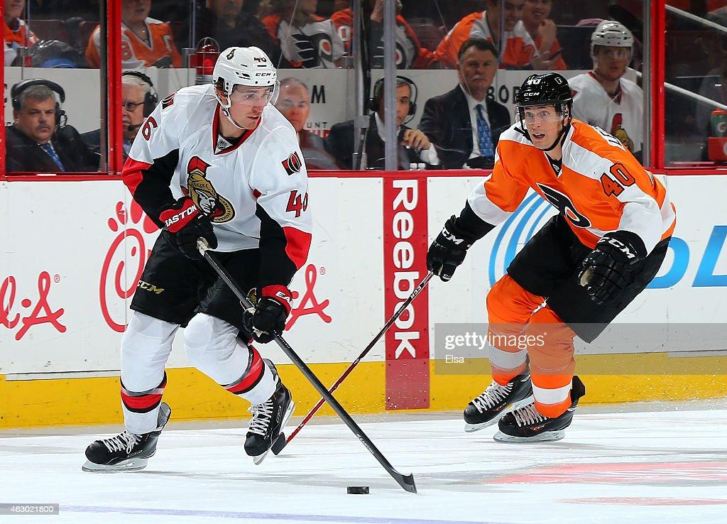 Patrick Wiercioch #46 of the Ottawa Senators takes the puck as Vincent Lecavalier #40 of the Philadelphia Flyers defends on January 6, 2015 at the Wells Fargo Center in Philadelphia, Pennsylvania.