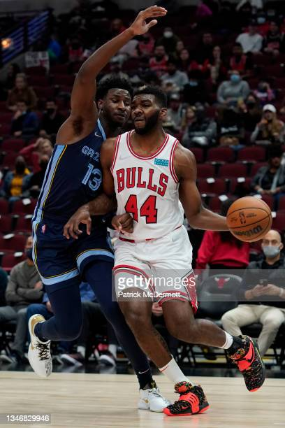 Patrick Williams of the Chicago Bulls dribbles the ball against Jaren Jackson Jr. #13 of the Memphis Grizzlies in the first half during a preseason...