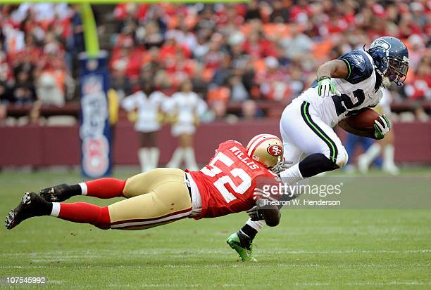 Patrick Willis of the San Francisco 49ers dives at the ankles of Marshawn Lynch of the Seattle Seahawks during an NFL football game at Candlestick...