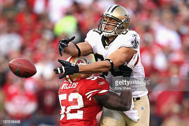 Patrick Willis of the San Francisco 49ers forces an incomplete pass against Jimmy Graham of the New Orleans Saints during the fourth quarter of the...