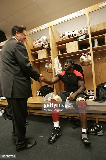 Patrick Willis of the San Francisco 49ers greets Dr John York in the locker room before the NFL game against the Chicago Bears at Soldier Field on...