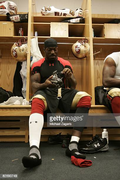 Patrick Willis of the San Francisco 49ers prepares in the locker room before the NFL game against the Chicago Bears at Soldier Field on August 21...