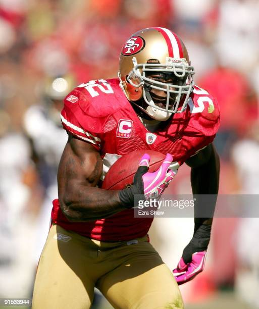 Patrick Willis of the San Francisco 49ers returns a interception for a touchdown during their game against the St. Louis Rams at Candlestick Park on...
