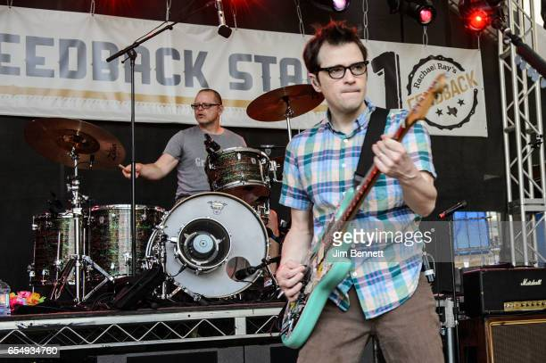 Patrick Wilson and Rivers Cuomo of Weezer perform live at Rachael Ray's Feedback party during SxSW at Stubb's BBQ on March 18 2017 in Austin Texas