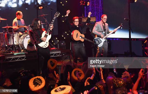 Patrick Wilson Brian Bell Rivers Cuomo and Scott Shriner of Weezer perform onstage during Dick Clark's New Year's Rockin' Eve With Ryan Seacrest 2019...