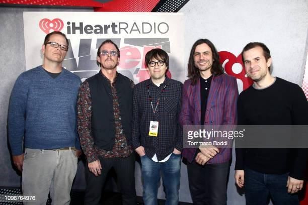 USE>> Patrick Wilson Scott Shriner Rivers Cuomo and Brian Bell of Weezer pose with Andrew Harms backstage during 2019 iHeartRadio ALTer Ego at The...