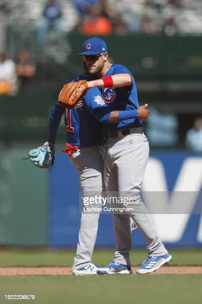 Patrick Wisdom of the Chicago Cubs celebrates with Sergio Alcantara after their win against the San Francisco Giants at Oracle Park on June 06, 2021...