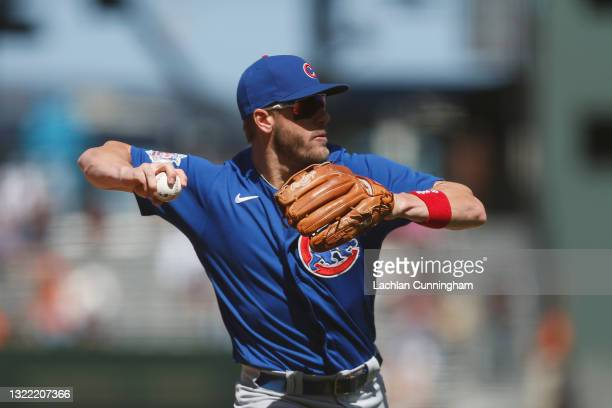 Patrick Wisdom of the Chicago Cubs fields a ball hit by Mike Tauchman of the San Francisco Giants in the bottom of the eighth inning at Oracle Park...