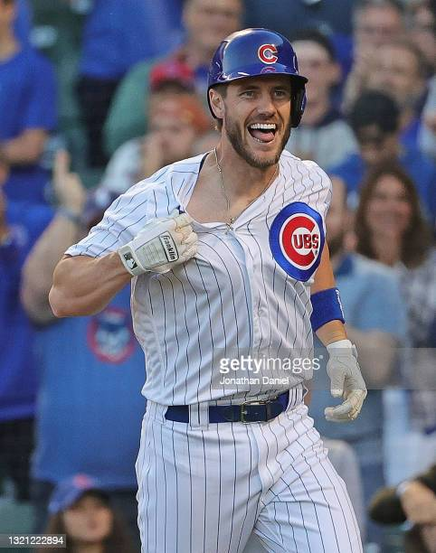 Patrick Wisdom of the Chicago Cubs pulls on his jersey in celebration after hitting a two run home run in the 2nd inning against the San Diego Padres...