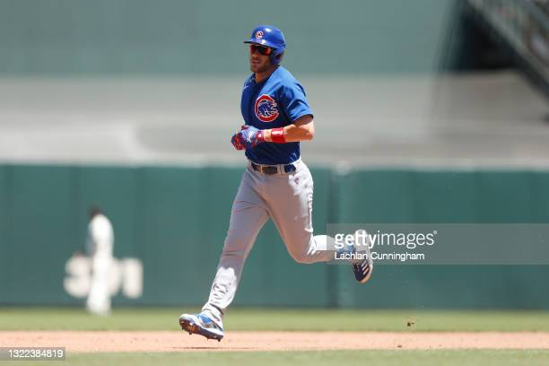 Patrick Wisdom of the Chicago Cubs rounds the bases after hitting a two-run home run against the San Francisco Giants at Oracle Park on June 06, 2021...