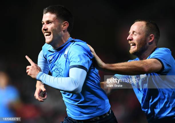 Patrick Wood of Sydney FC celebrates after scoring his teams fourth goal with Ryhan Grant of Sydney FC during the A-League match between Adelaide...