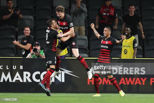 Patrick Ziegler of the Wanderers celebrates scoring a goal with team mates during the round 11 W-League match between the Western Sydney Wanderers...