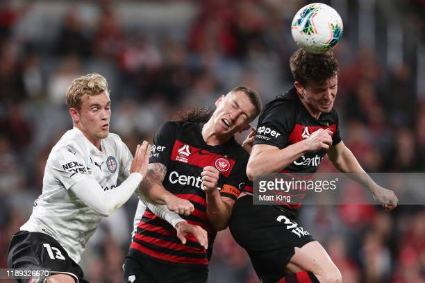 Patrick Zielger of the Wanderers heads the ball next to team mate Mitchell Duke and Nathaniel Atkinson of Melbourne City FC during the round 7...