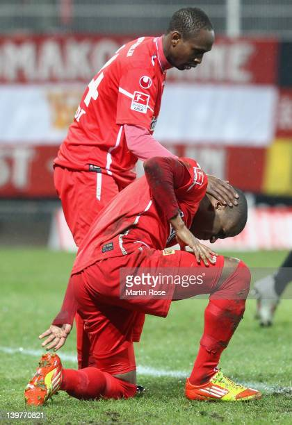 Patrick Zoundi of Berlin comforts team mate Oliveira Silvio after he fails to score during the Second Bundesliga match between 1.FC Union Berlin and...