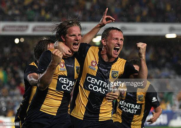 Patrick Zwaanswijk and Daniel McBreen of the Mariners celebrate after Zwaanswijk scored his teams third and winning goal during the round nine...