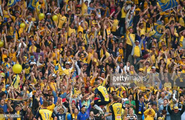 Patrick Zwaanswijk of the Mariners celebrates after scoring his team's first goal during the ALeague 2013 Grand Final match between the Western...