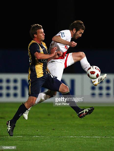 Patrick Zwaanswijk of the Mariners competes for the ball against Dean Heffernan of the Heart during the round six A-League match between the Central...
