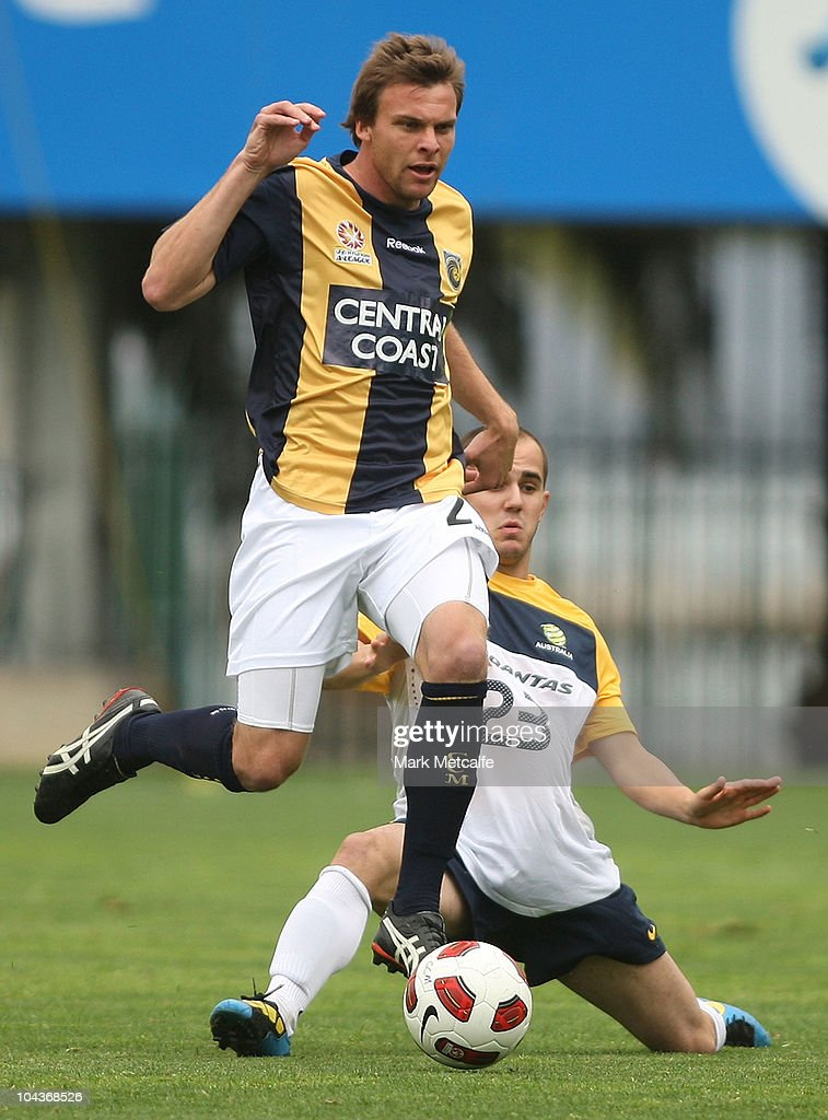 Patrick Zwaanswijk of the Mariners evades the tackle of Steven Lustica of the Young Socceroos uring the friendly match between the Young Socceroos and the Central Coast Mariners at Bluetongue Stadium on September 23, 2010 in Gosford, Australia.