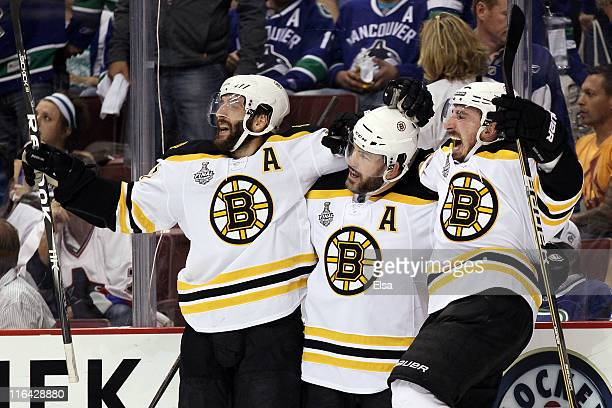 Patricne Bergeron Mark Recchi and Brad Marchand of the Boston Bruins celebrate after an open goal scored in the third period against Roberto Luongo...