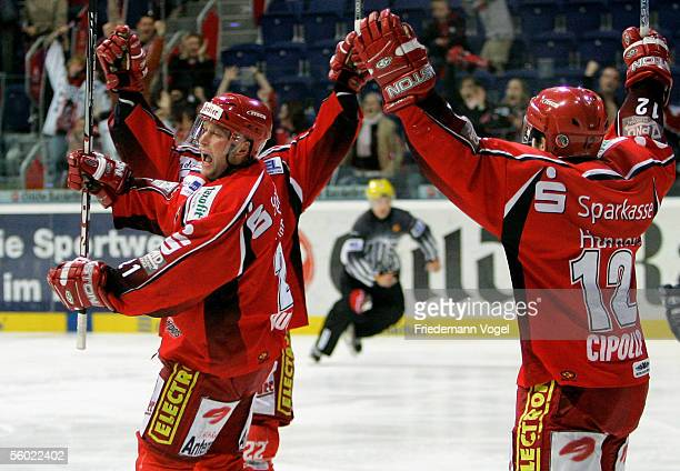 Patrik Augusta celebrates scoring the first goal with Jason Cipolla of Hanover during the DEL match between Hanover Scorpions and Adler Mannheim at...